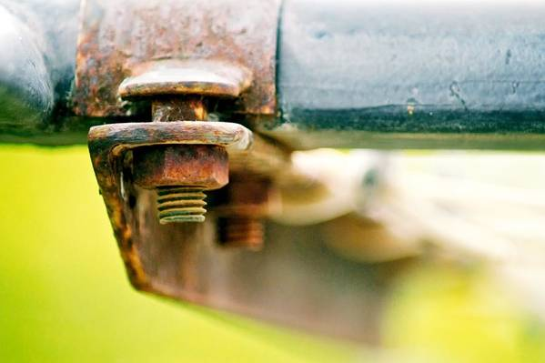 Bokeh Art Print featuring the photograph Nuts And Bolts by Michael Tzacostas