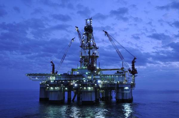 Oil Rig Print featuring the photograph Oil Rig At Twilight by Bradford Martin