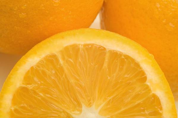 Close Print featuring the photograph Oranges by Darren Greenwood