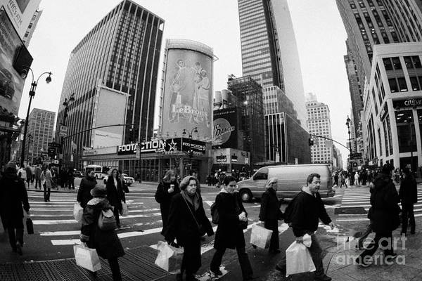 Usa Art Print featuring the photograph Pedestrians Crossing Crosswalk On 7th Ave And 34th Street Outside Macys New York City Usa by Joe Fox