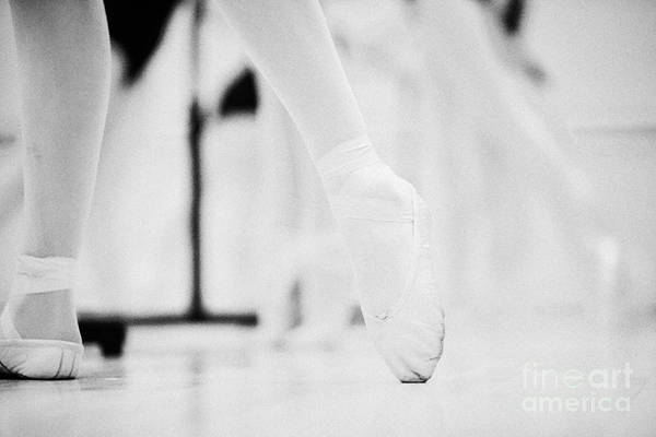 Ballet Art Print featuring the photograph Pointed Toe In Ballet Slippers At A Ballet School In The Uk by Joe Fox