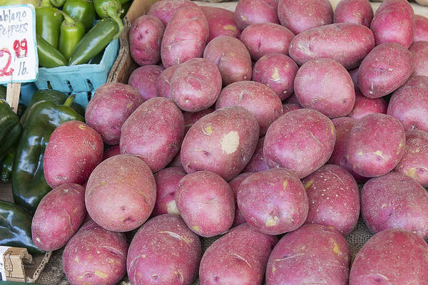 Red Art Print featuring the photograph Red Skin Potatoes Stall Display by JPLDesigns
