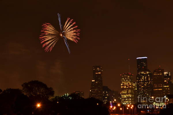Downtown Houston Skyline Art Print featuring the photograph Red White And Blue Firework by Aaron Edrington