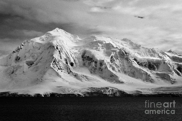 Snow Art Print featuring the photograph snow covered landscape of anvers island mountain range and neumayer channel Antarctica by Joe Fox