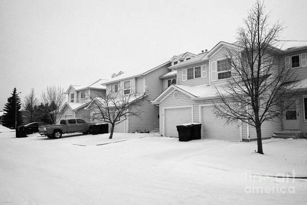Snow Art Print featuring the photograph snow falling in residential street during winter Saskatoon Saskatchewan Canada by Joe Fox
