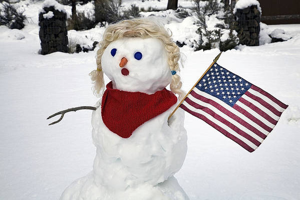 Snowman; Snowmen; Winter Storm; Winter; Storm; Stormy; Snow; Snowy; Winter Fun; Family Fun; Scarf; Cowboy Hat; Stetson; Carrot Nose; Building A Snowman; Frosty; Snow People; American Flag; Flags; Old Glory; Scarf; Red Scarf; People Outside; People Outdoors; Snow Storm Art Print featuring the photograph Snow Woman With Flag by Buddy Mays