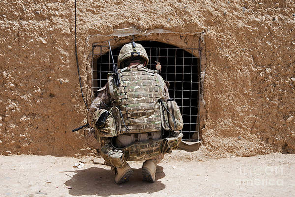 Us Marines Art Print featuring the photograph Soldier Searches A Compound by Stocktrek Images