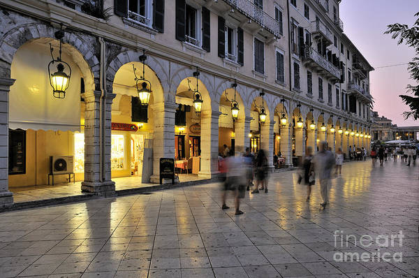 Corfu; Kerkyra; Old; City; People; Tourists; Walk; Walking; Dusk; Twilight; Lights; Spianada; Square; Ionion; Ionian; Greece; Hellas; Greek; Hellenic; Island; Europe; Prints Art Print featuring the photograph Spianada Square During Dusk Time by George Atsametakis