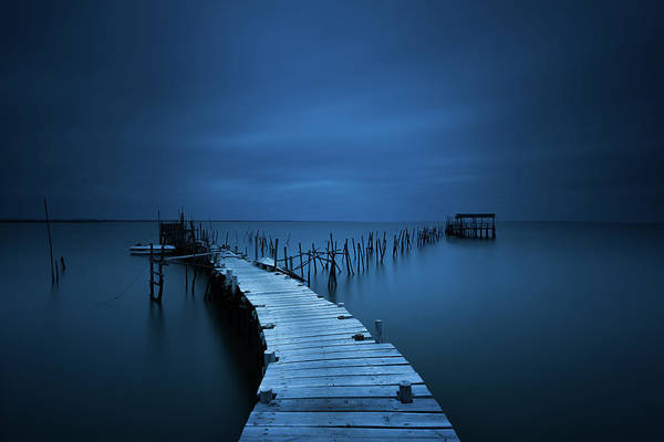 Calm Art Print featuring the photograph Stilts by Miguel Moreno