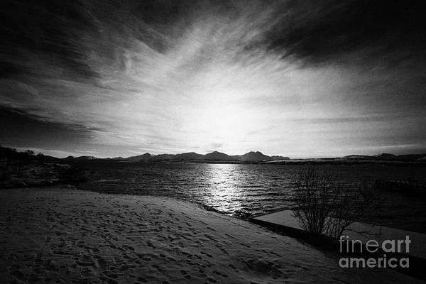 Telegrafbukta Art Print featuring the photograph sun setting with halo over snow covered telegrafbukta beach Tromso troms Norway europe by Joe Fox