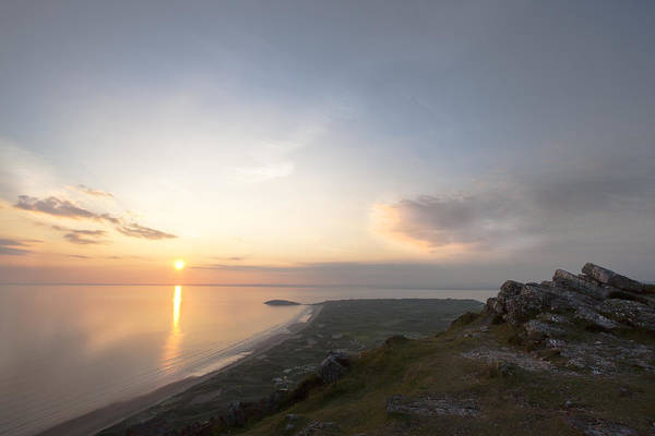 Rhossili Beach Gower Swansea S Wales Beach Sunset Burry Holm Headland Rocks Sea Clouds Art Print featuring the photograph Sunset From Rhossili Down by Jo Evans