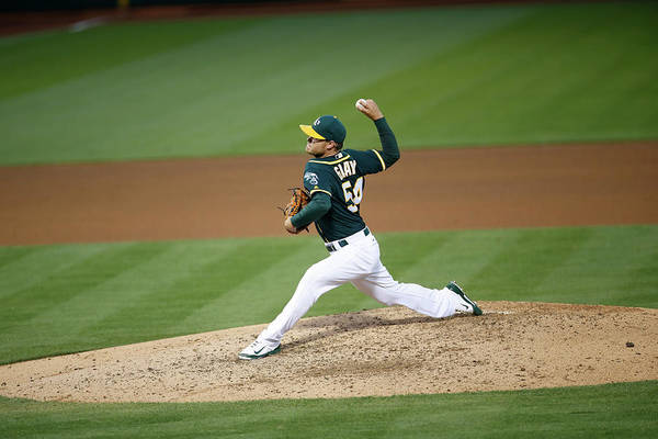 People Art Print featuring the photograph Tampa Bay Rays V Oakland Athletics by Michael Zagaris