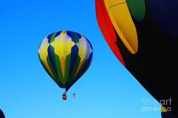 Balloons Art Print featuring the photograph The First One Up by Jeff Swan