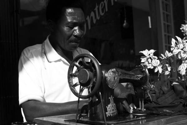 People Art Print featuring the photograph The Tailor - Tanzania by Aidan Moran