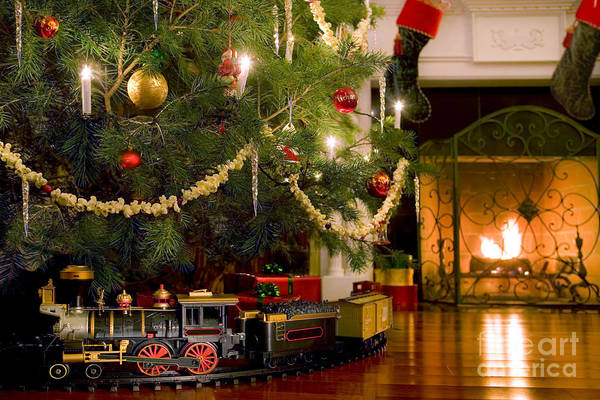 Christmas Art Print featuring the photograph Toy Train Under The Christmas Tree by Diane Diederich