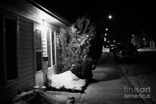 Traditional Art Print featuring the photograph Traditional House With Porch Light Outside The Door And Snow Cleared Pavements At Night Delisle Sask by Joe Fox