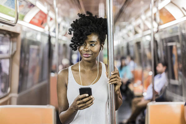 Mid Adult Women Art Print featuring the photograph Usa, New York City, Manhattan, Portrait Of Relaxed Woman With Cell Phone In Underground Train by Westend61