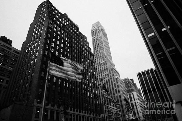 Usa Print featuring the photograph view of pennsylvania bldg nelson tower and US flags flying on 34th street from 1 penn plaza nyc by Joe Fox