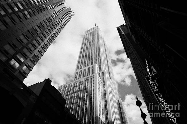 Usa Art Print featuring the photograph View Of The Empire State Building And Surrounding Buildings And Cloudy Sky West 33rd Street New York by Joe Fox