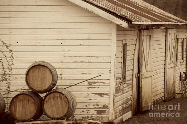 Architecture And Building Art Print featuring the photograph Wine Barrels And Rustic White Barn by Juli Scalzi
