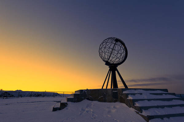 Longitude; Latitude; Arctic; Cape; Concept; Europe; European; Evening; Famous; Globe; Monument; Nature; Nordkapp; North; Northern; Northland; Norway; Norwegian; Point; Postcard; Scandinavia; Sign; Silhouette; Sky; Sphere; Statue; Sun; Sunset; Symbol; Symbolic; Tourism; Travel; View; World; Northernmost Point; Dawn; Dusk; Golden Art Print featuring the photograph Winter Beyond The Arctic Circle by Ulrich Schade