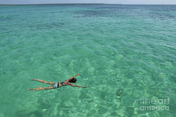 People Print featuring the photograph Woman Snorkeling By Turquoise Sea by Sami Sarkis