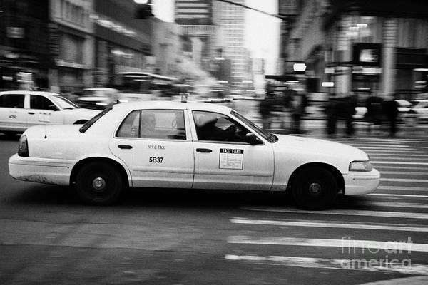 Usa Art Print featuring the photograph Yellow Cab Blurring Past Crosswalk And Pedestrians New York City Usa by Joe Fox