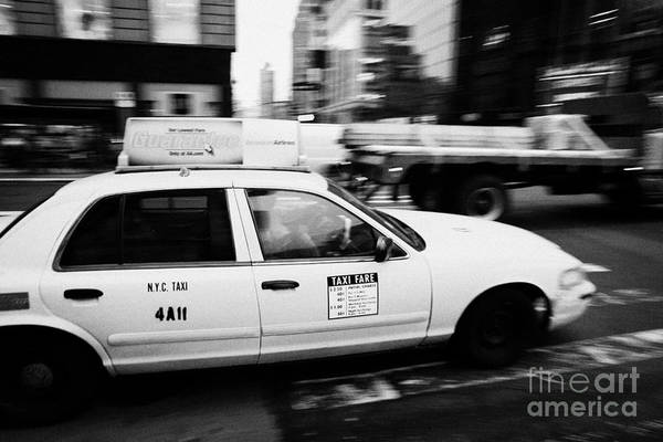 Usa Art Print featuring the photograph Yellow Cab With Advertising Hoarding Blurring Past Crosswalk And Pedestrians New York City Usa by Joe Fox