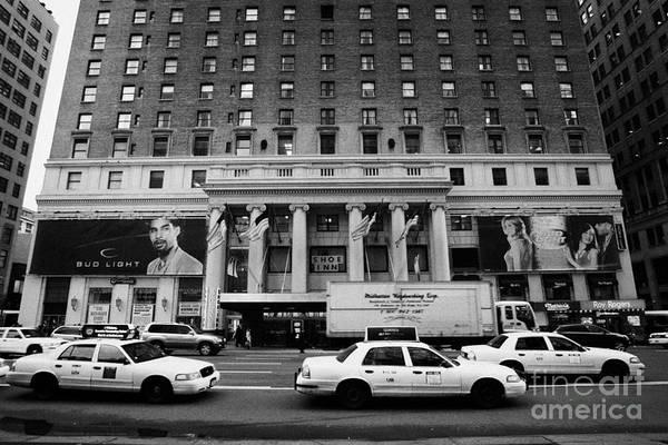 Usa Art Print featuring the photograph Yellow Cabs Go Past Pennsylvania Hotel On 7th Avenue New York City Usa by Joe Fox