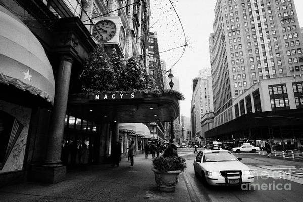 Usa Art Print featuring the photograph yellow taxi cab waits outside entrance to Macys department store on Broadway and 34th street by Joe Fox