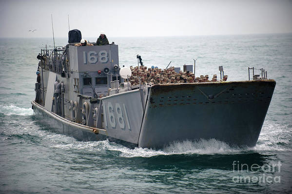 Warship Art Print featuring the photograph A Landing Craft Utility Transits by Stocktrek Images
