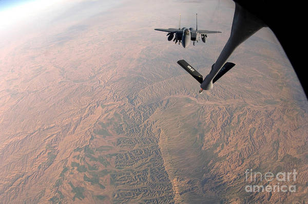 Color Image Art Print featuring the photograph An F-15e Strike Eagle Is Refueled by Stocktrek Images