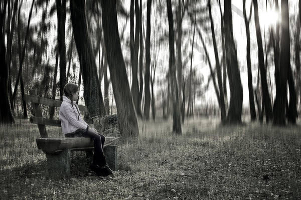 Girls Art Print featuring the photograph Girl Sitting On A Wooden Bench In The Forest Against The Light by Joana Kruse