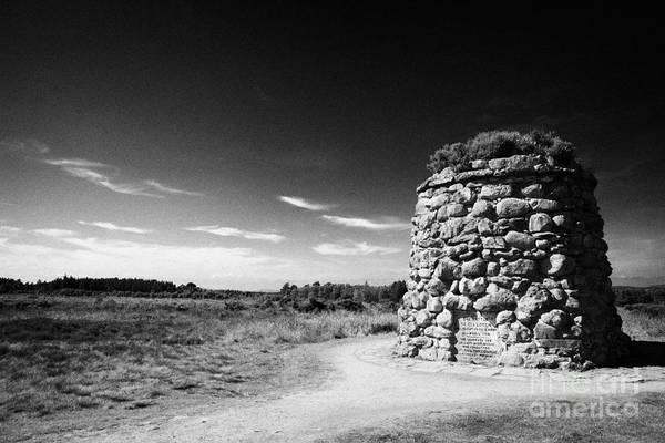 The Art Print featuring the photograph the memorial cairn on Culloden moor battlefield site highlands scotland by Joe Fox