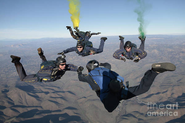 Skydiving Art Print featuring the photograph The U.s. Navy Parachute Demonstration by Stocktrek Images