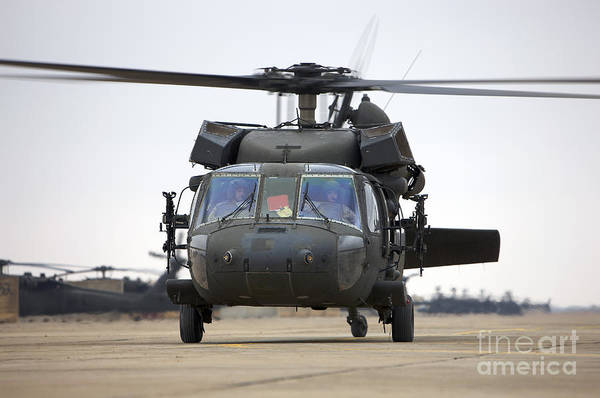 Aviation Art Print featuring the photograph A Uh-60 Black Hawk Taxis by Terry Moore