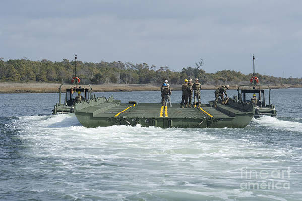Exercise Bold Alligator Art Print featuring the photograph Marines And Sailors Tow An Improved by Stocktrek Images