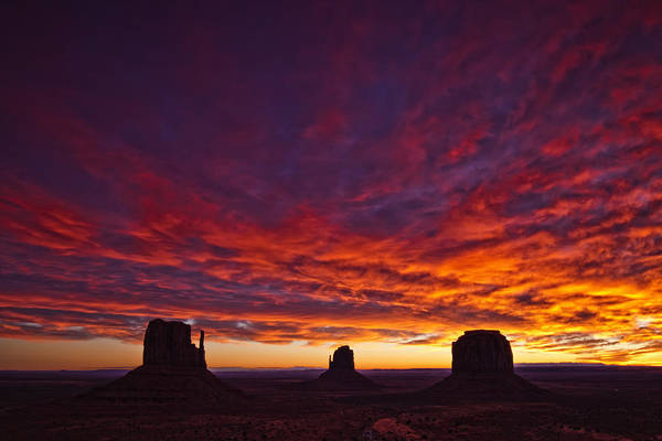 Light Art Print featuring the photograph Sunrise Over Monument Valley, Arizona by Robert Postma