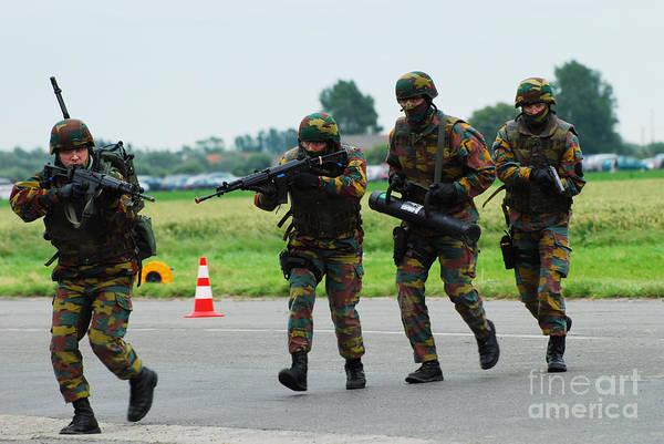 Aiming Print featuring the photograph Belgian Paracommandos Entering by Luc De Jaeger