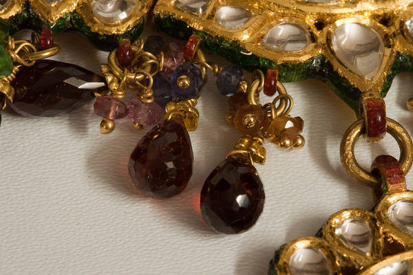 Stone Art Print featuring the photograph 3 Hanging Semi-precious Stones Attached To A Green And Gold Necklace by Ashish Agarwal