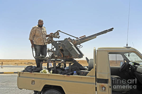 Ajadabiya Art Print featuring the photograph A Free Libyan Army Pickup Truck by Andrew Chittock