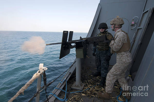 Shooting Art Print featuring the photograph A Marine Fires A .50-caliber Machine by Stocktrek Images