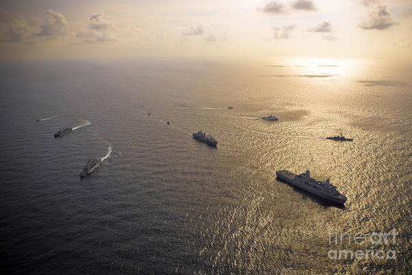 Reflecting Print featuring the photograph A Multi-national Naval Force Navigates by Stocktrek Images