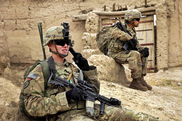 Afghanistan National Police Print featuring the photograph A Soldier Calls In Description by Stocktrek Images