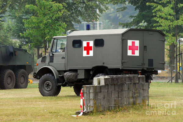 Military Art Print featuring the photograph A Unimog In An Ambulance Version In Use by Luc De Jaeger
