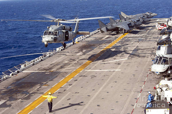 Underway Replenishment Art Print featuring the photograph An Mh-60s Seahawk Helicopter Prepares by Stocktrek Images