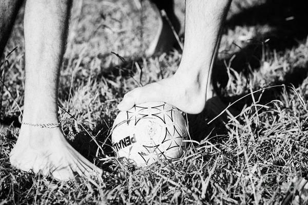 Men Art Print featuring the photograph Argentinian Hispanic Men Start A Football Game Barefoot In The Park On Grass by Joe Fox