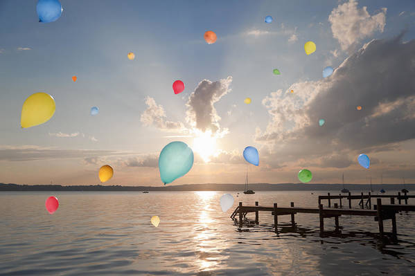 Horizontal Art Print featuring the photograph Balloons Floating Over Still Lake by Henglein and Steets