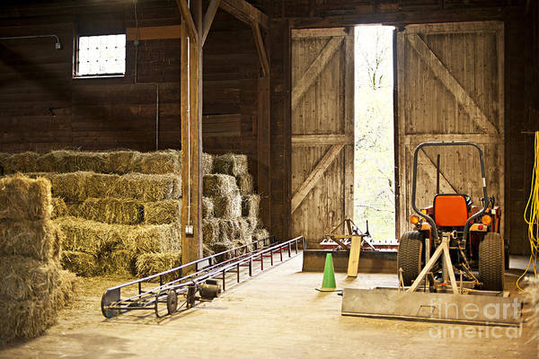 Barn Art Print featuring the photograph Barn With Hay Bales And Farm Equipment by Elena Elisseeva