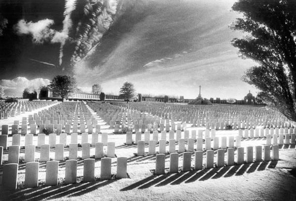 First World War; One; 1; Wwi; Ww1; 1st; I; Graves; Gravestones; Tombstones; Belgian; Commemorative; War Memorial; Vast; Stark; Shadows; Eerie; Atmospheric; Bright; Sunlight; Cross; Rows Art Print featuring the photograph British Cemetery by Simon Marsden